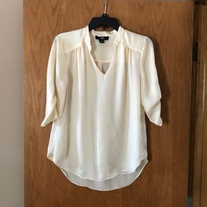 Cream colored blouse with 3/4 sleeves